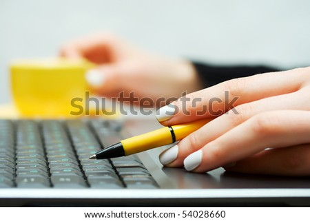 Female hand working on laptop.