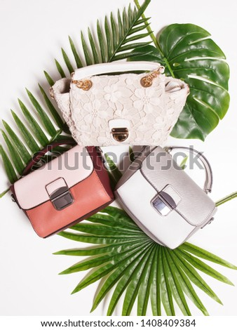 Female handbags, flat lay background