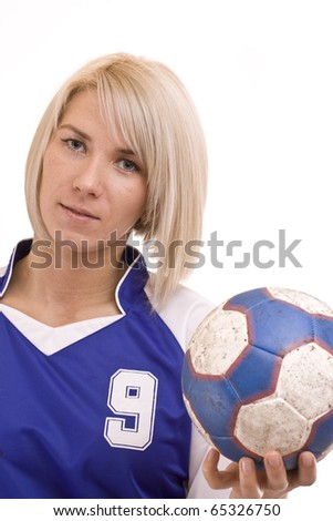 female handball player with a used ball, isolated in white