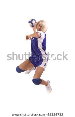 female handball player with a used ball make exercise