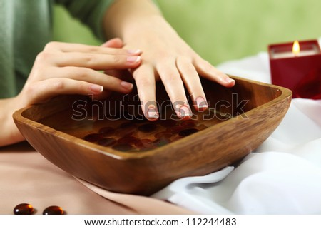Female hands and manicure related objects in spa salon