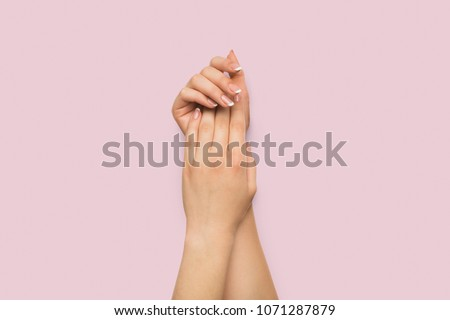 Female hands applying cream at pink background. Beauty, tenderness and skincare concept, copy space #1071287879