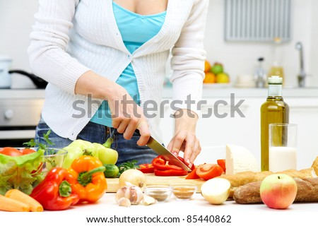 Female hands cooking healthy dinner at kitchen
