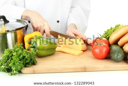 Female hands cutting cheese, isolated on white - stock photo