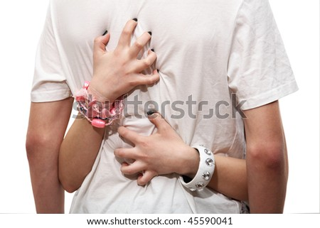 Female hands embrace a man's back