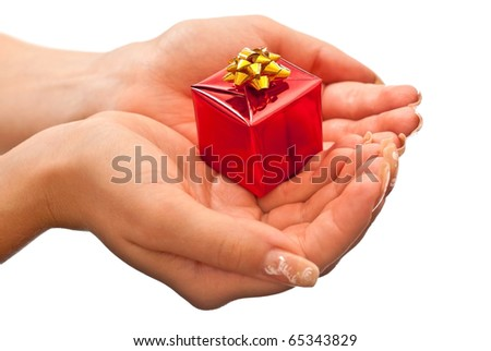 Female hands giving a christmas gift. Isolated on white