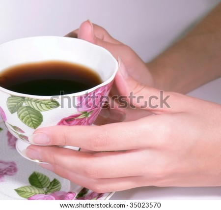 Female hands hold a coffee cup #35023570