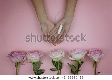 Female hands hold hygienic tampon. Feminine hygiene concept