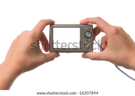 Female hands holding a compact camera over white