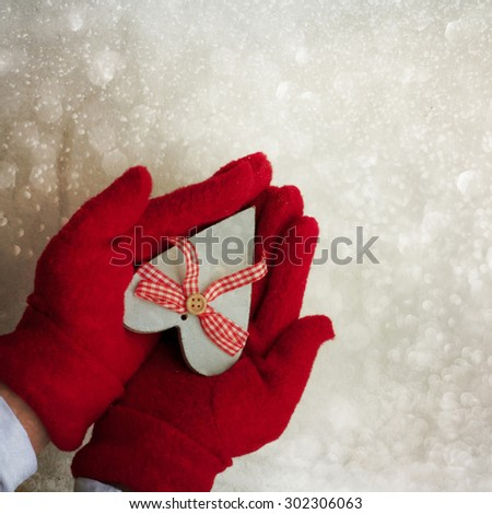 Female hands holding a gift #302306063