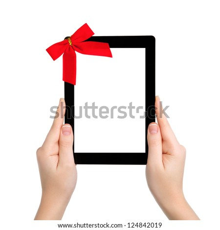 female hands holding a tablet touch computer gadget with isolated screen and a red gift bow - stock photo