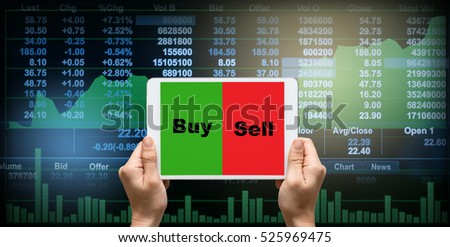 female hands holding a tablet touch screen showing buy and sell over the Stock market chart,Closeup Stock market exchange data on LED display, business trading concept