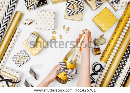 female hands holding champagne bottle on white background festive background for holidays birthday