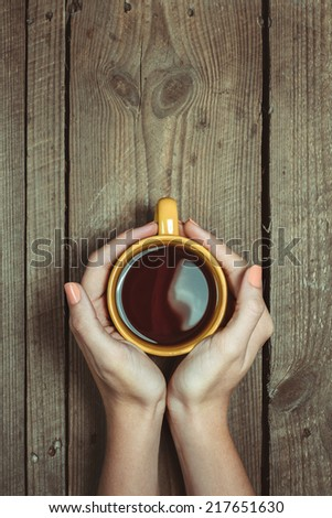 Female Hands Holding Cup Of Coffee