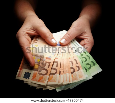 female hands holding european paper currency