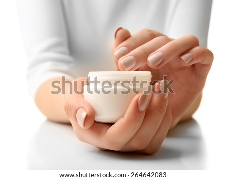 Female hands holding jar of cream isolated on white