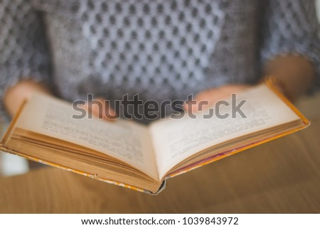 female hands holding old book...