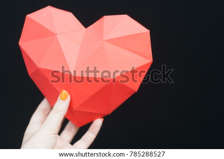 Female hands holding red polygonal heart shape. Heart Shape, Paper, Symbol, Human Hand. #785288527