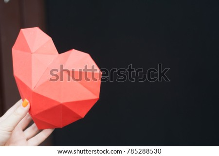 Female hands holding red polygonal heart shape. Heart Shape, Paper, Symbol, Human Hand. #785288530