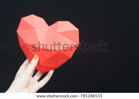Female hands holding red polygonal heart shape. Heart Shape, Paper, Symbol, Human Hand. #785288533