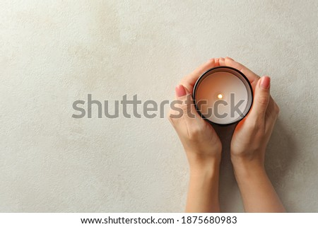Female hands holding scented candle, top view ストックフォト ©
