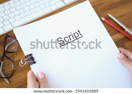 Female hands holding script over table closeup Foto d'archivio ©