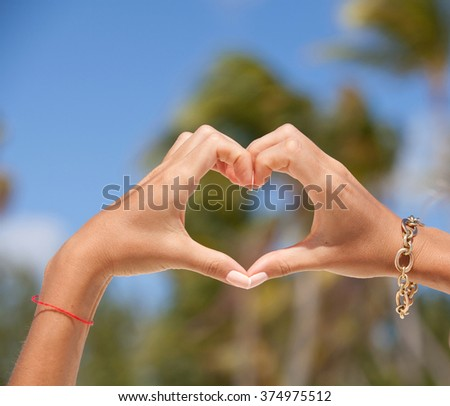 Female hands in the form of heart. Hands in shape of love heart. Love and tourism concept. #374975512