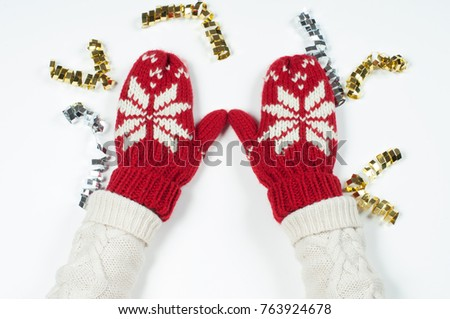 Female hands in winter red mittens on white background #763924678