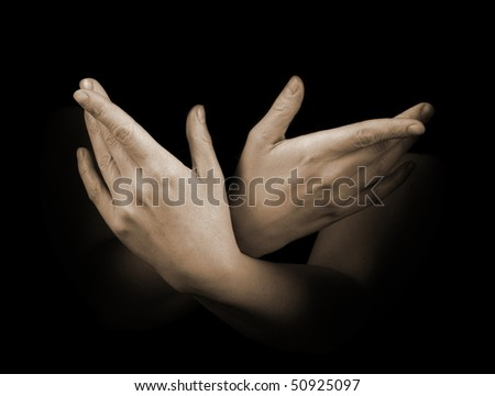 Female hands isolated on black background