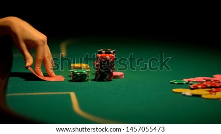 Female hands looking at cards, losing combination in poker, bluffing, bad luck