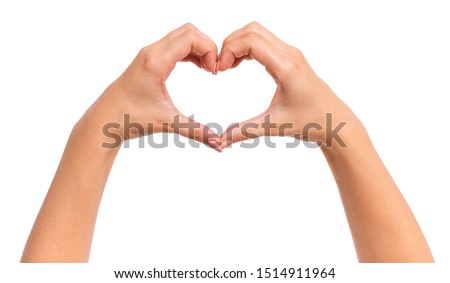 Photo of  Female hands making sign Heart by fingers, isolated on white background. Beautiful hands of woman with copy space. Love concept on Valentine day.