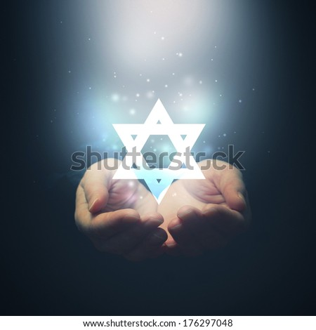 Female hands opening to light and David\'s star. Jewish religion