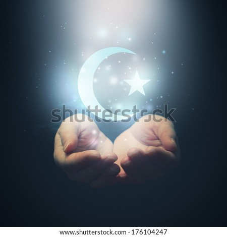 Female hands opening to light and half moon and star symbol of islam religion