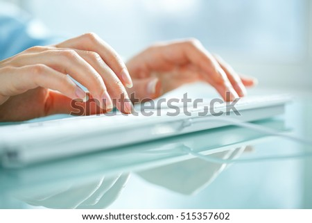 Female hands or woman office worker typing on the keyboard #515357602