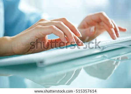 Female hands or woman office worker typing on the keyboard #515357614