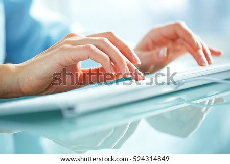 Female hands or woman office worker typing on the keyboard #524314849