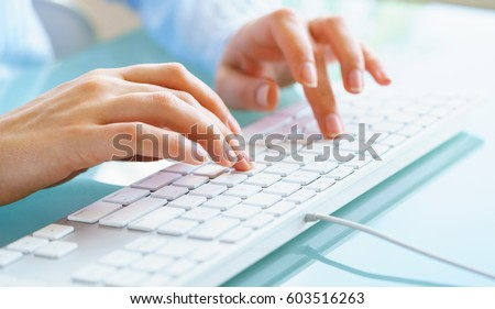Female hands or woman office worker typing on the keyboard #603516263
