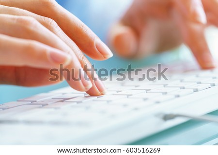 Female hands or woman office worker typing on the keyboard #603516269