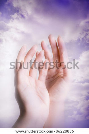 female hands over sky like a spiritual concept