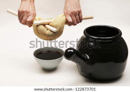 Female hands pressing out tea