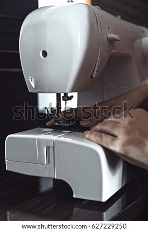 Female Hands Sew On A Sewing Machine EZ Canvas Stunning Ez Sewing Machine