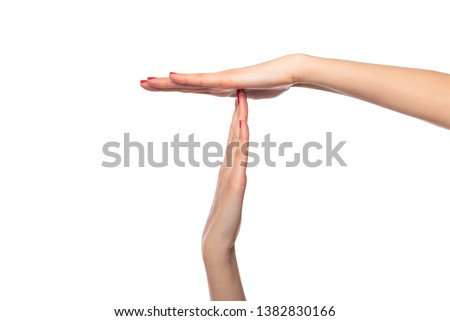 Female hands show a timeout or pause sign on a white background. Stock photo ©