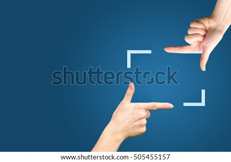 Photo of  Female hands showing cropping composition gesture. Isolated on blue.