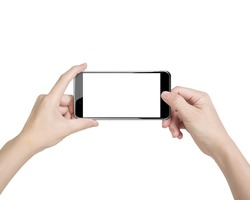 Female hands taking photo with smart phone of blank white touch screen, front view, isolated on white.