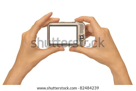 female hands taking picture with a compact digital camera