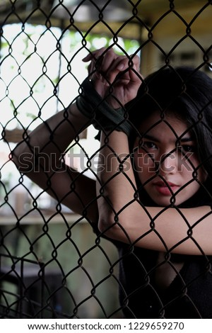 Caged Woman Tied