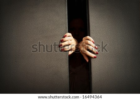 Female hands try to stop doors of the closed lift