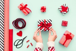 Female hands tying a red bow. Birthday, Valentines day, Christmas, New Year. Flat lay