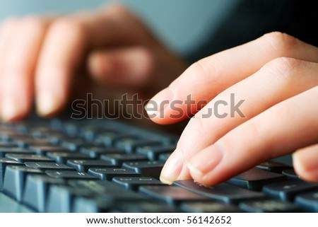 Female hands typing.