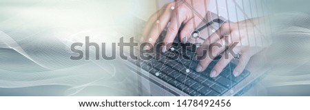 Female hands typing on a laptop keyboard, double exposure; panoramic banner